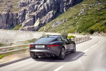 2015-jaguar-f-type-r-coupe-rear-three-quarters-in-motion
