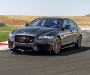 2016-jaguar-xf-s-awd-front-side-view-on-track-around-corner